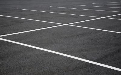 Close focus image of a generic parking lot.