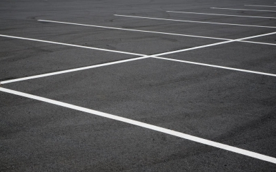 Close focus image of a generic parking lot.